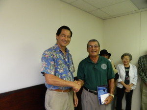Foundation President Art Fujita accepts Grant from Glenn Hong, CEO of  Young Brothers
