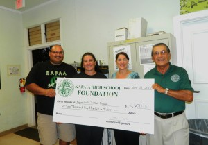 Scot and Aulani Kaui accept grant from Foundation board member Shellie Domingsil and President Art Fujita