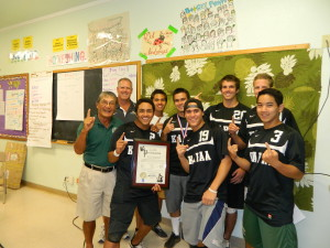 Kapaa Boys Soccer team celebrate with Foundation President Art Fujita