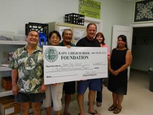 Bob Kubota, Barbara Yamane, and Art Fujita present check to Paul Sousa