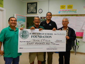 Greg Gonsalves accept a check for $800 from Board members Bob Kubota, Art Fujita, and Daniel Hamada