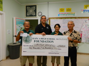 Athletic Director Greg Gonsalves receive $1500 from Foundation board members Art Fujita, Barbara Yamane, and Daniel Hamada