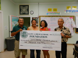 Kara Kitamura(second from left) accepts award from President Art Fujita, Vice President Renee Sadang and Principal Daniel Hamada