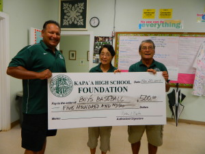 Baseball coach Bryan Aiwohi accepts check from Foundation Board members Barbara Yamane and Art Fujita