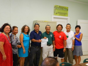 Dennis Esaki presents  check to Foundation President Art Fujita in behalf of  Kapaa High Class of 1969