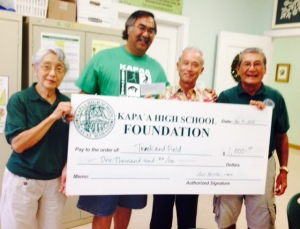 Track and Field Coach Ron Valesco accepts check from Board members Barbara Yamane , Daniel Hamada, and Art Fujita