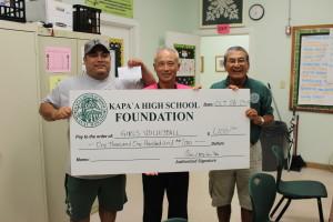 Principal Danny Hamada and Calvin Paleka accept Foundation check for Girls Volleyball