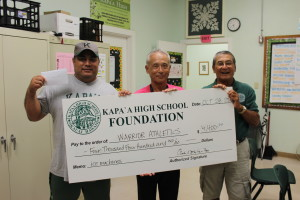 Principal Danny Hamada and Coach Calvin Paleka accept check to purchase two new ice machines for Athletic Department