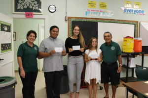 Jalen Yago, Kunani Tuttle, and Rukiyah Walker accept Foundation Grants of $1000 each from Board members Shellie Domingcil and Art Fujita. Missing from Photo : Sara Morimoto and Coleman Langstaff